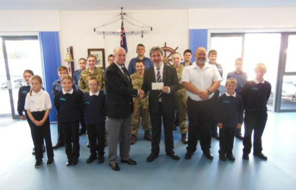 Tony Griffin of Exmouth Sea Cadets receives a cheque from Freemason Reuben Ayres. Archant